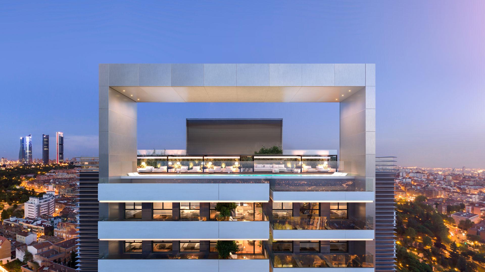 Vista frontal de la piscina panorámica en terraza con las cuatro torres al fondo